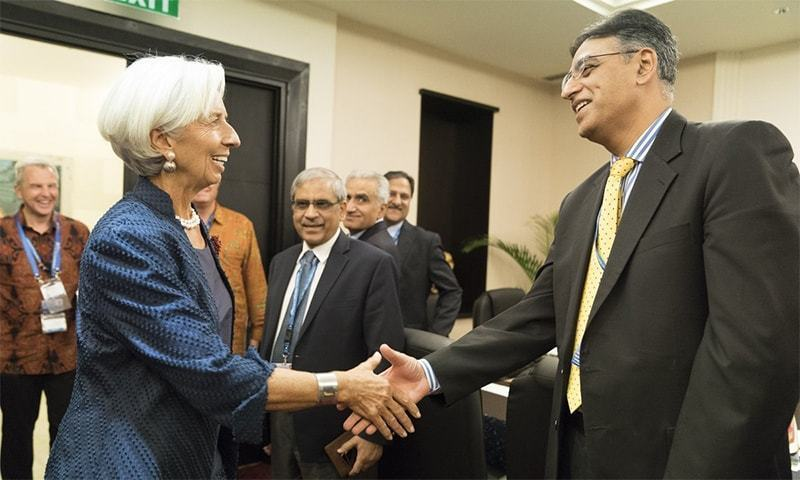 IMF Managing Director Christina Lagarde and Finance Minister Asad Umar shake hands at a meeting. — File photo