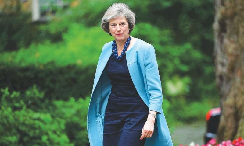 May, Blair trade Brexit snipes