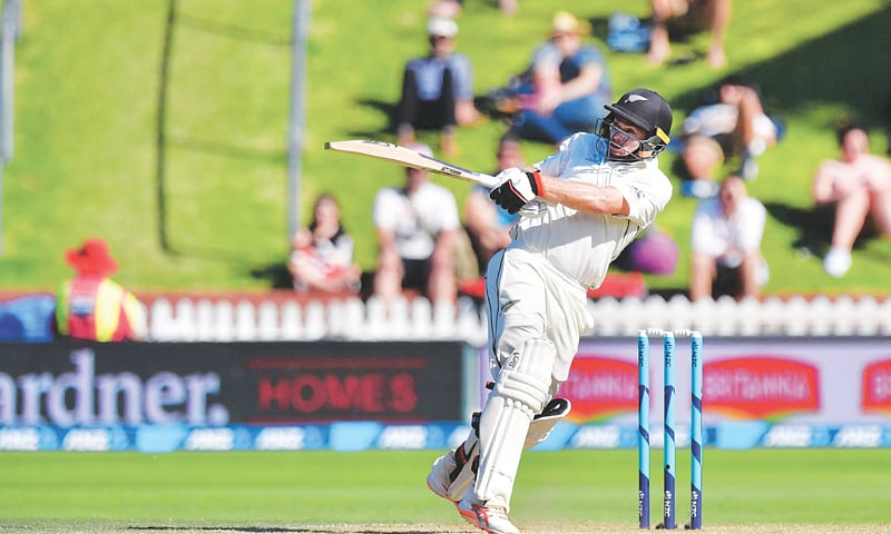 WELLINGTON: New Zealand opener Tom Latham plays a pull shot during his marathon knock in the first Test against Sri Lanka on Monday.—AFP