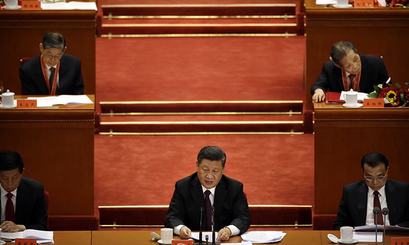 Chinese President Xi Jinping speaks during a conference to commemorate the 40th anniversary of China's Reform and Opening Up policy at the Great Hall of the People in Beijing on Tuesday. — AP