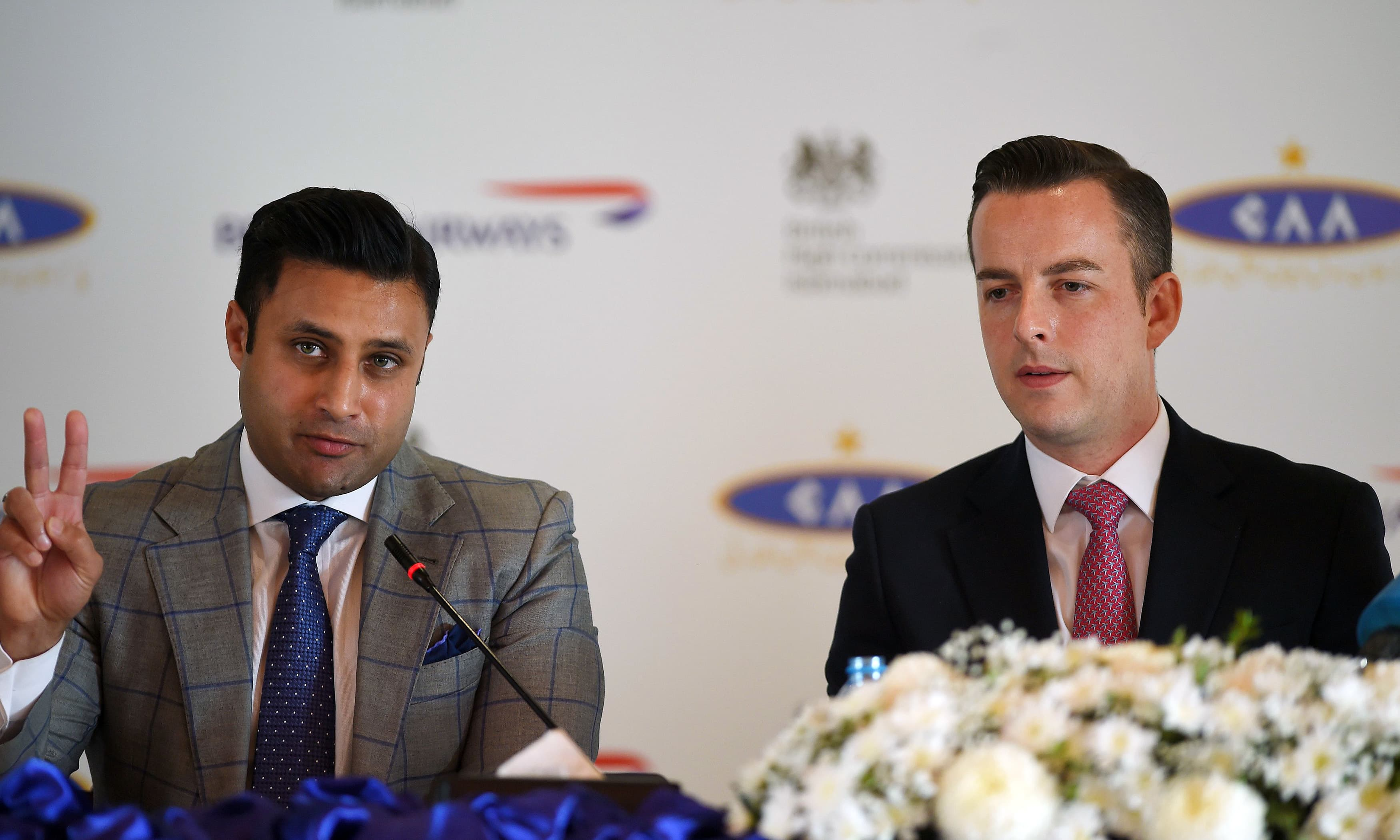 Special Assistant to PM for Overseas Pakistanis Zulfi Bukhari gestures as he sits along with Robert Williams, British Airways head of Sales for Asia Pacific and the Middle East during a press conference in Islamabad. —AFP