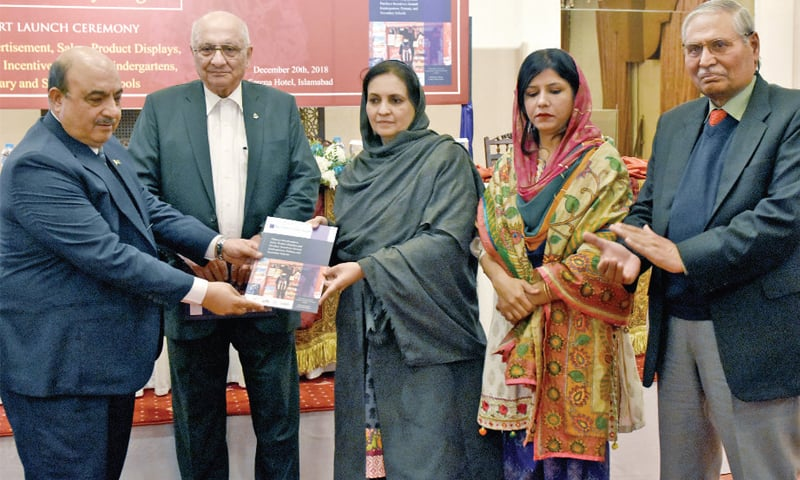 Chief Executive Officer, Human Development Foundation, Azhar Saleem presents the report to Dr Nausheen Hamid, Federal Parliamentary Secretary for National Health Services. — Photo by Tanveer Shahzad