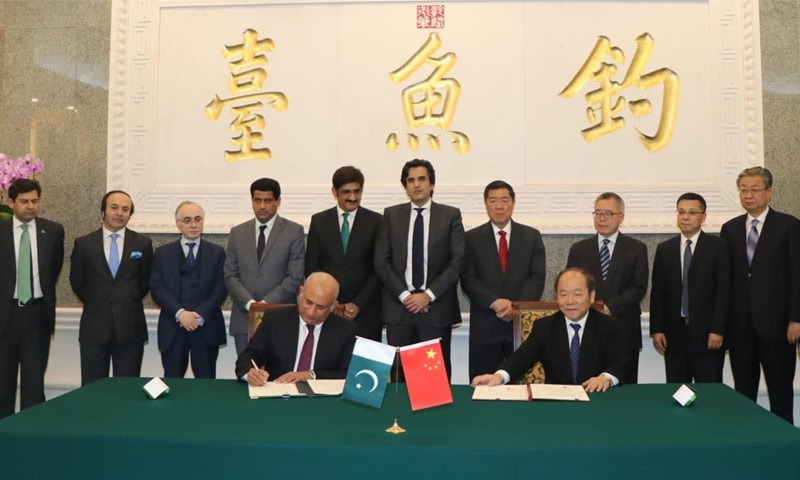 BEIJING: Board of Investment chairman Haroon Sharif and National Development and Reform Commission vice chairman Ning Jizhe sign the agreement on Thursday.—APP