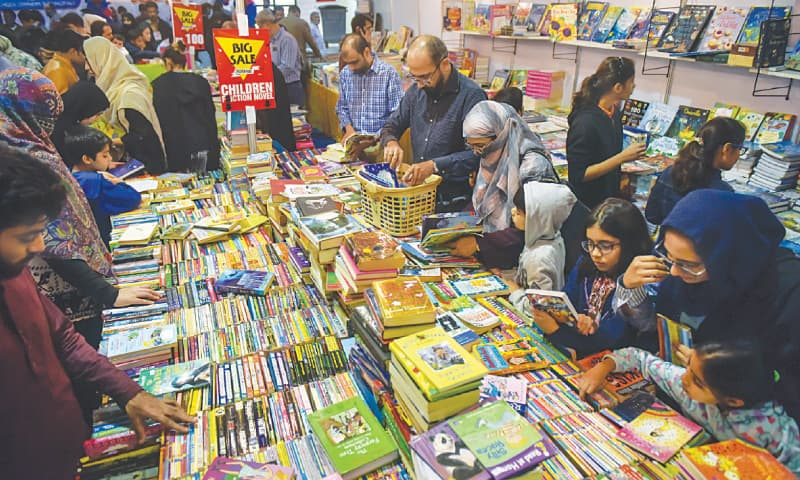PEOPLE go through a variety of titles at the book fair on Friday.—White Star