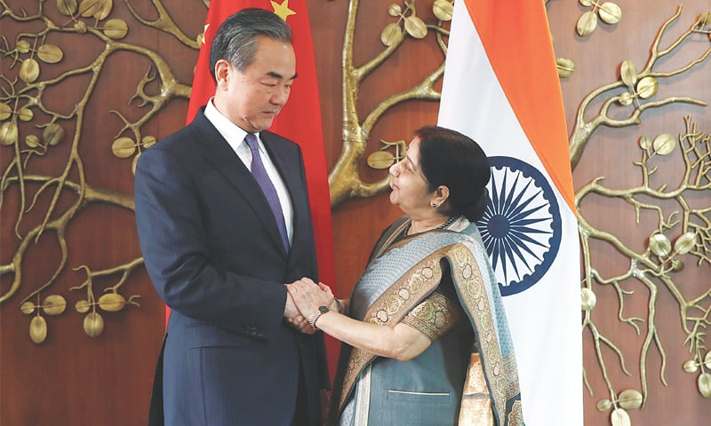 New Delhi: Chinese Foreign Minister Wang Yi shakes hands with his Indian counterpart Sushma Swaraj before their meeting on Friday.—Reuters