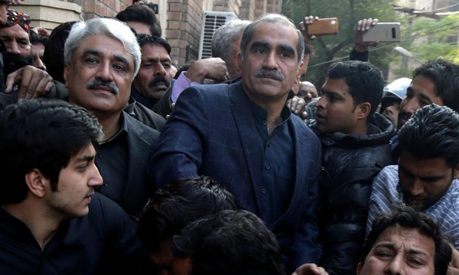 Khawaja Saad Rafque (R) and brother Khawaja Salman Rafique (L) arrested by NAB authorities in Paragon Housing Society scam. — AP