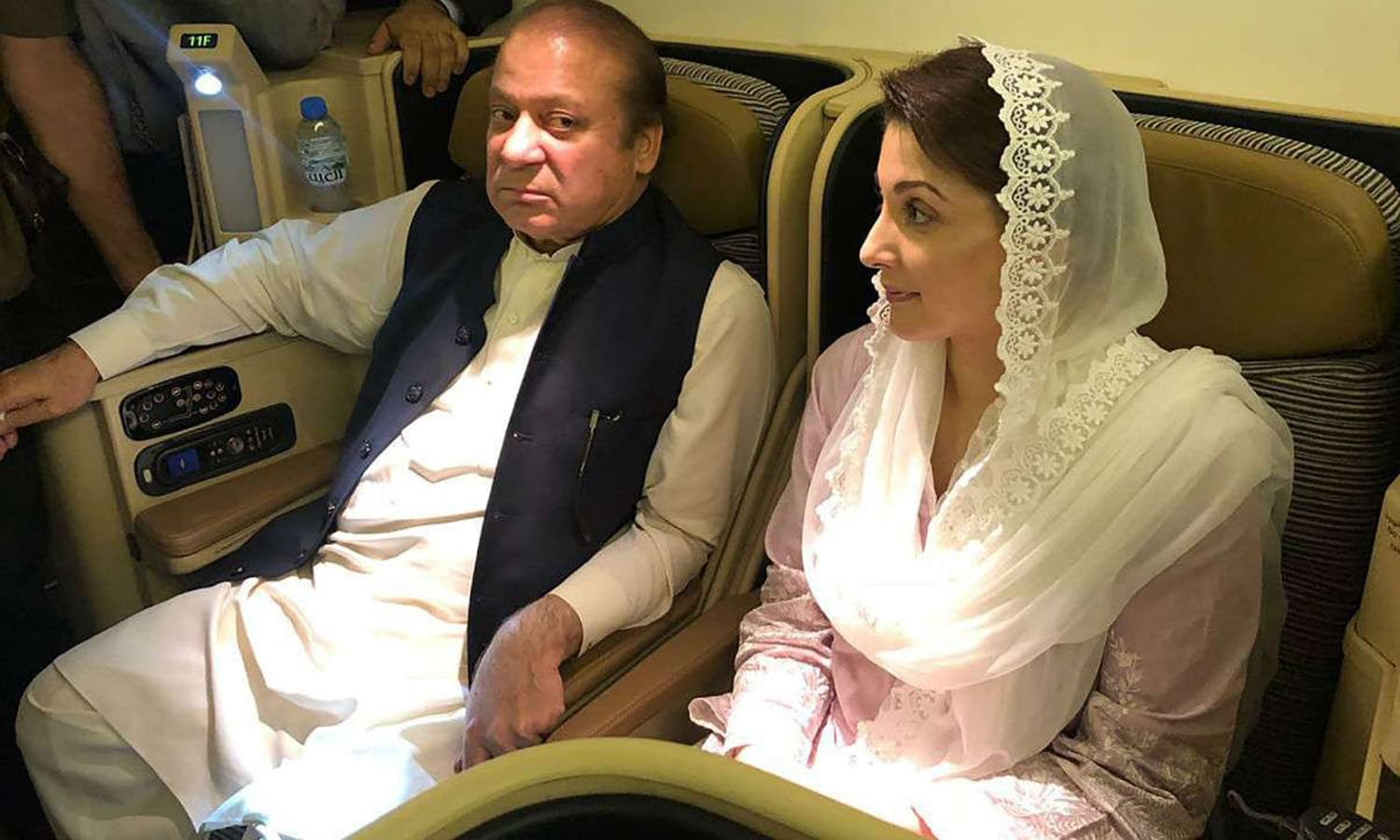 Nawaz Sharif and daughter Maryam on a Lahore-bound flight on July 13, 2018 to surrender to NAB. — AFP