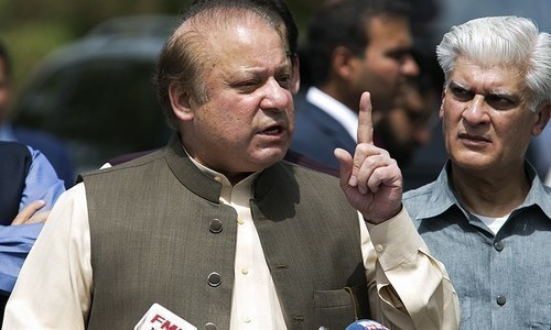 Former premier Nawaz Sharif talks outside an accountability court. — File photo