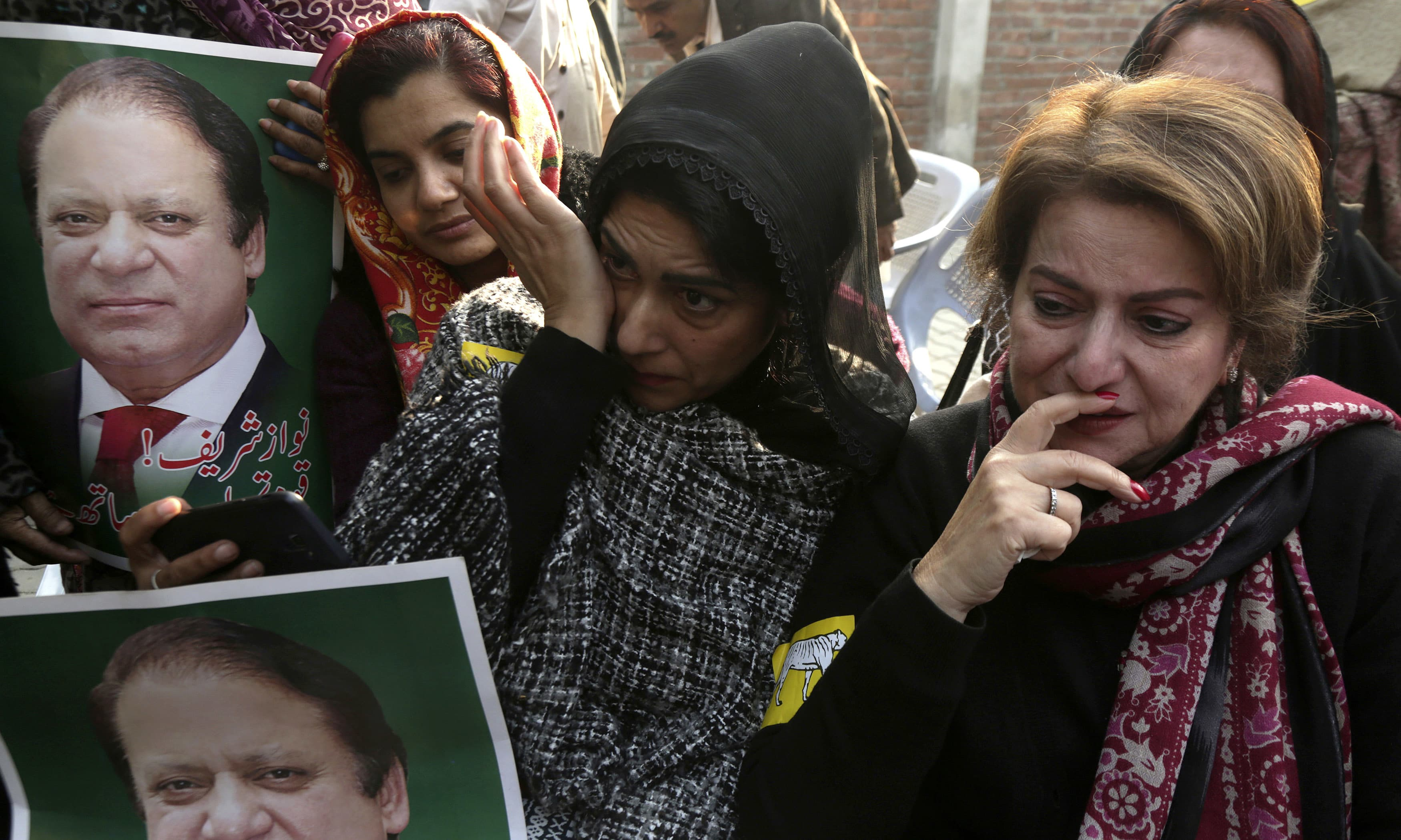 Grieving supporters of PML-N supreme leader Nawaz Sharif protest in Lahore against the court ruling. —AP