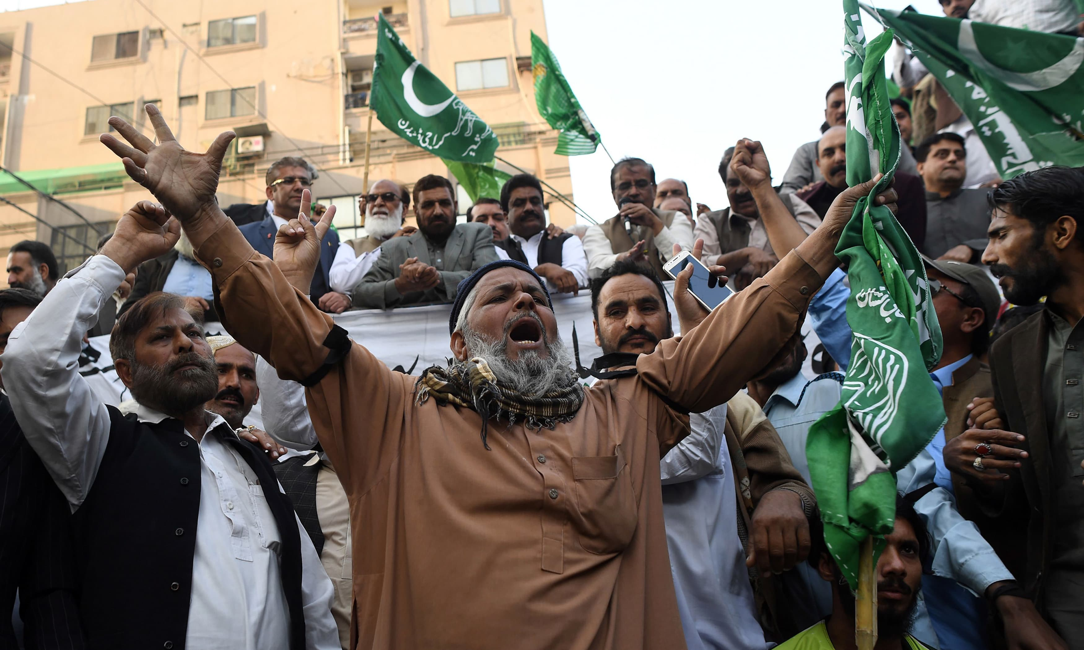 Supporters of former prime minister Nawaz Sharif gather outside the anti-corruption court in Islamabad ahead of the court verdict in the Al-Azizia and Flagship Investment cases. —AFP