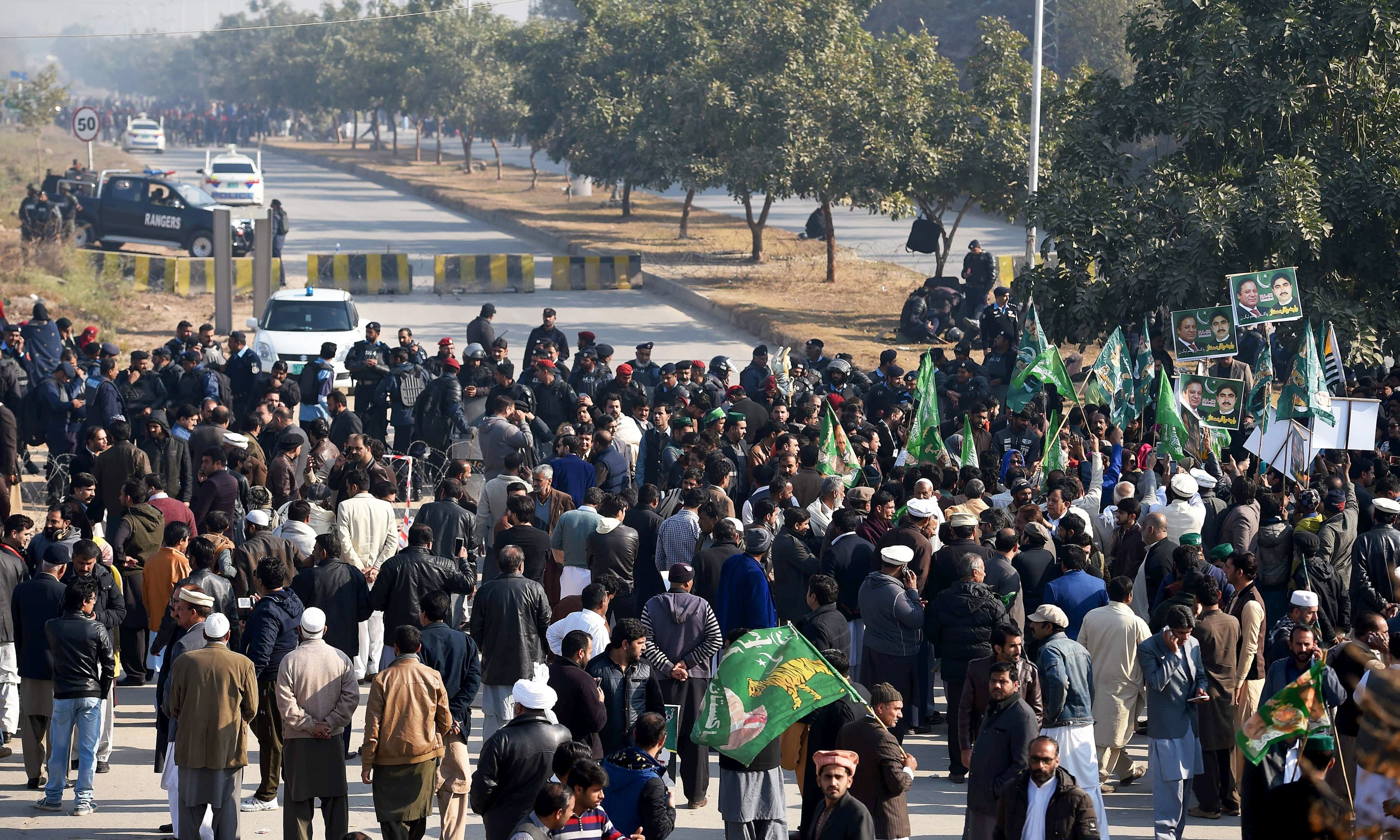 PML-N supporters gather outside the anti-corruption court in Islamabad. —AFP