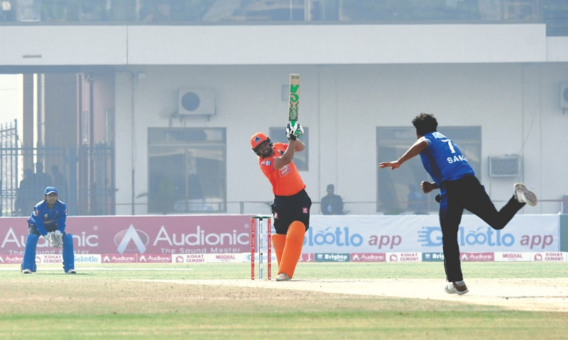 RAWALPINDI opener Naved Malik hits over the top during his 90-run knock against Karachi Whites.—PCB