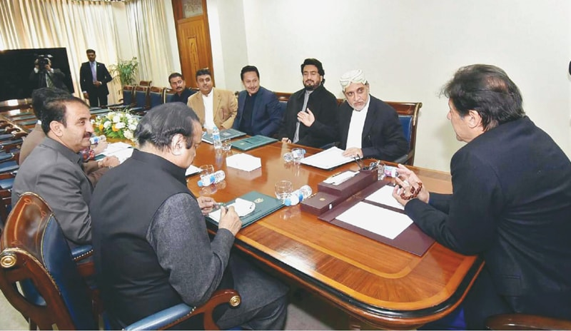 ISLAMABAD: Prime Minister Imran Khan exchanging views with lawmakers of Balochistan National Party-Mengal during a meeting at the PM Office on Monday.—PPI
