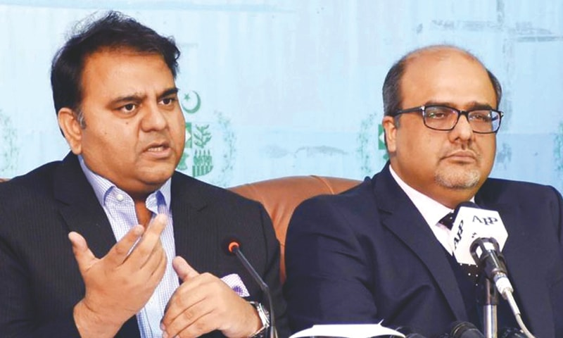 Information Minister Fawad Chaudhry speaks at a press conference with Special Assistant to the Prime Minister on Accountability Shahzad Akbar on Monday.—White Star