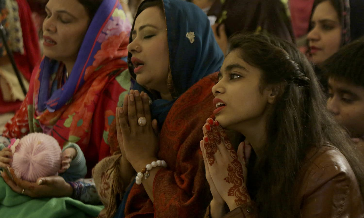 Christians attend a midnight service at St. Anthony's Church to celebrate the Christmas in Lahore. ─ AP
