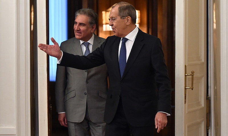 Russia's Foreign Minister Sergei Lavrov (R) welcomes Foreign Minister Shah Mehmood Qureshi during his visit to Moscow. —AFP
