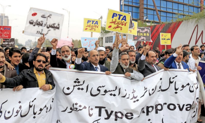 Members of All Pakistan Mobile Phone Traders Association protest outside National Press Club on Wednesday. — White Star