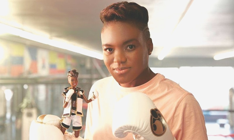 British boxer and Olympic gold medallist Nicola Adams holds a Barbie doll made in her likeness to mark International Women's Day.—Reuters