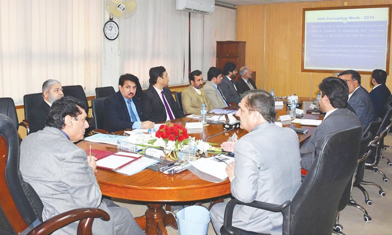 National Accountability Bureau chairman retired Justice Javed Iqbal presides over a meeting on Wednesday.—Online