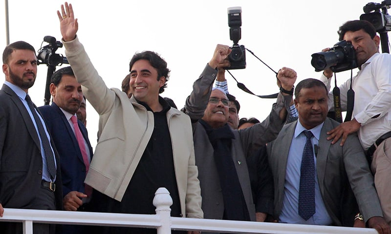 Bilawal Bhutto Zardari and Asif Ali Zardari raising hands to party workers on the 11th death anniversary of Benazir Bhutto at Garhi Khuda Bux. —APP