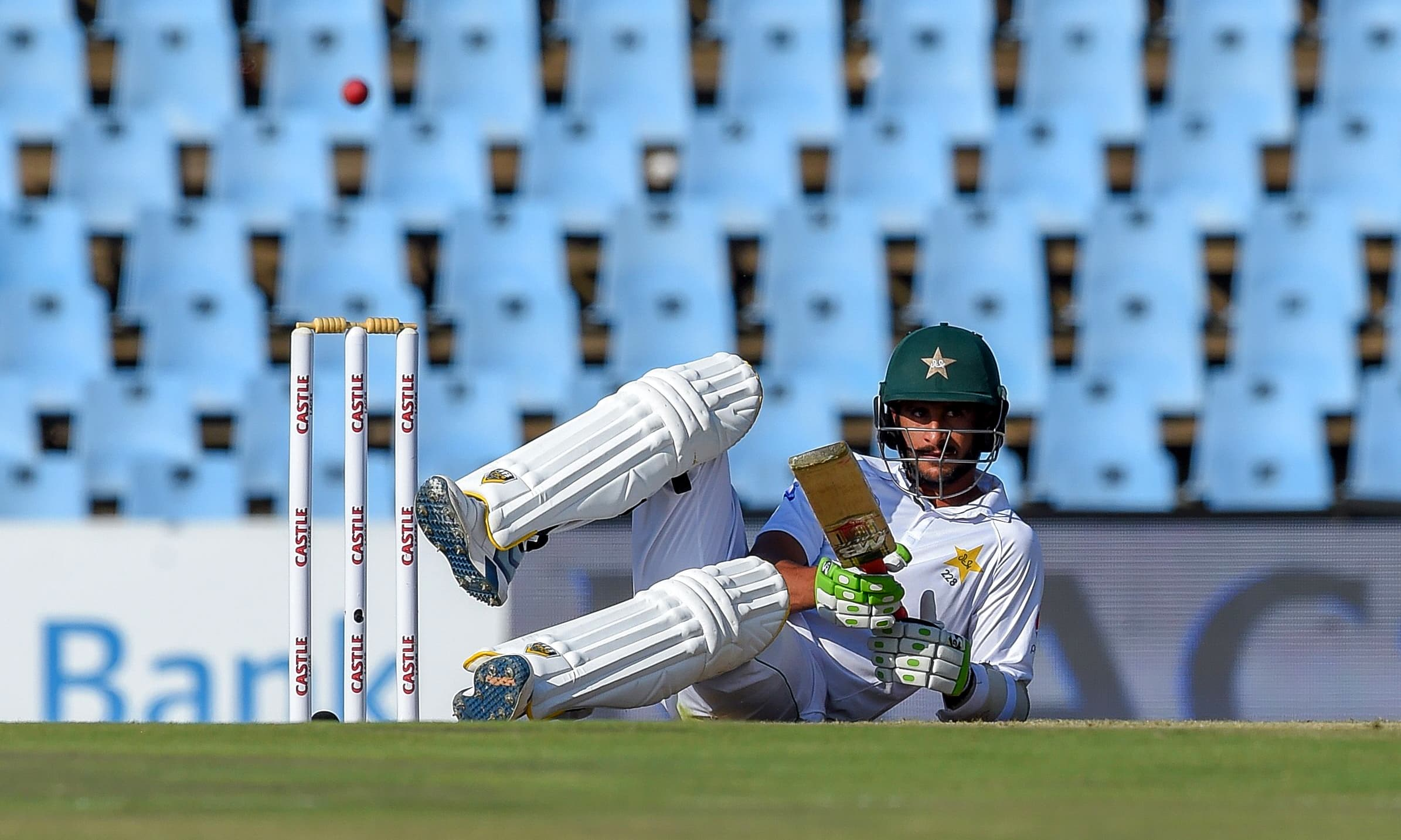 Hasan Ali reacts after falling while trying to duck a bouncer bowled by Duanne Olivier. —AFP