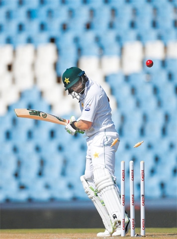 CENTURION: Pakistan opener Imam-ul-Haq is bowled by South African pacer Duanne Olivier during the first Test at the SuperSport Park on Thursday.—Reuters