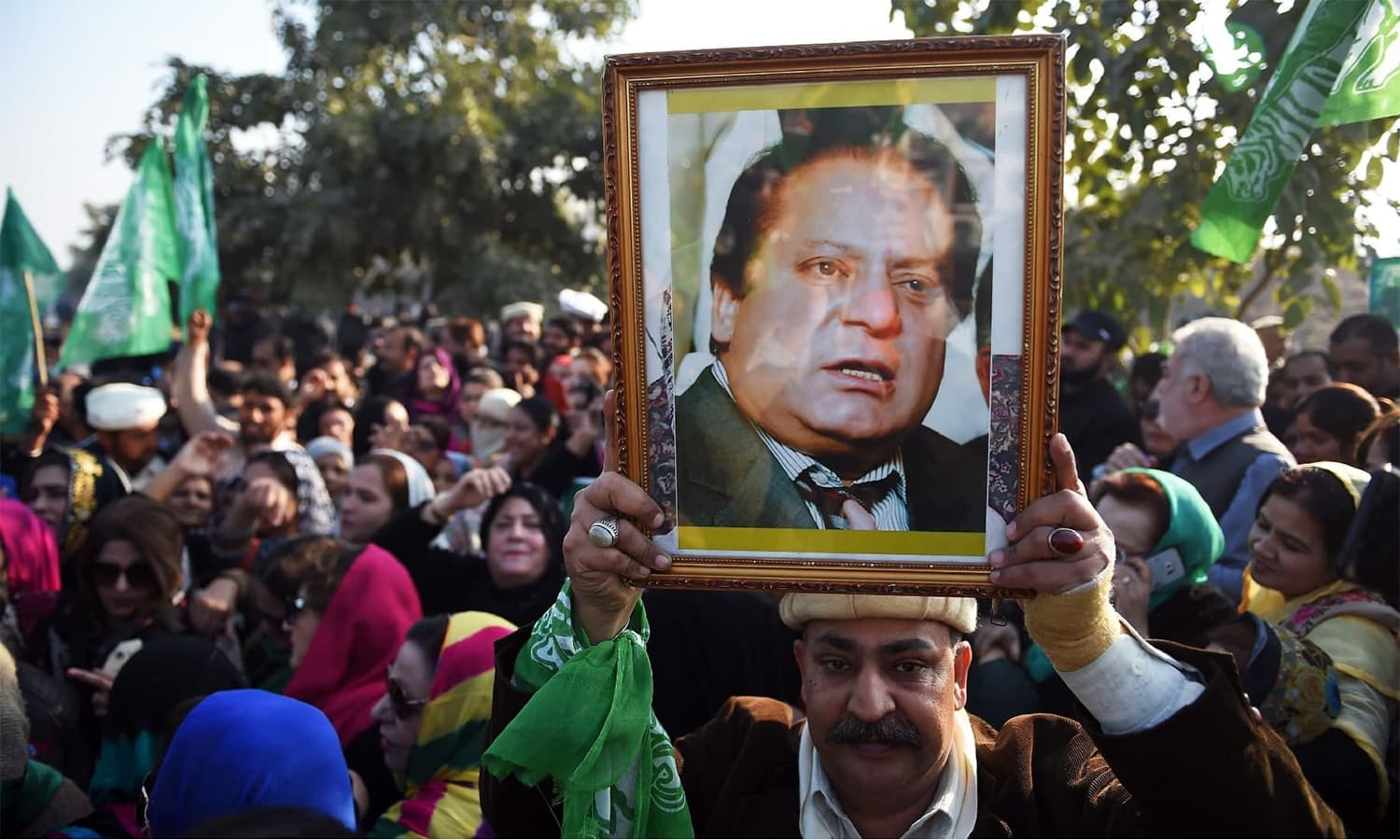 Supporters of Nawaz Sharif gather outside the anti-corruption court in Islamabad ahead of the court verdict in the Al-Azizia reference. — AFP