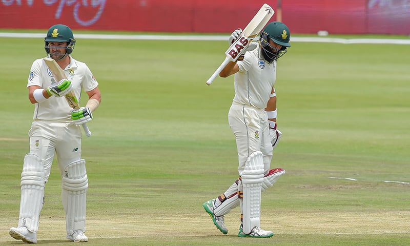 South Africa's Hashim Amla reactsafter scoring his fifty runs during day three of the 1st cricket test match between South Africa and Pakistan. —AFP