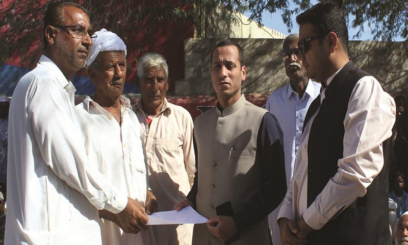 Additional Deputy Commissioner Anees Tariq Gorgage being presented with a list of demands. —Photo provided by author