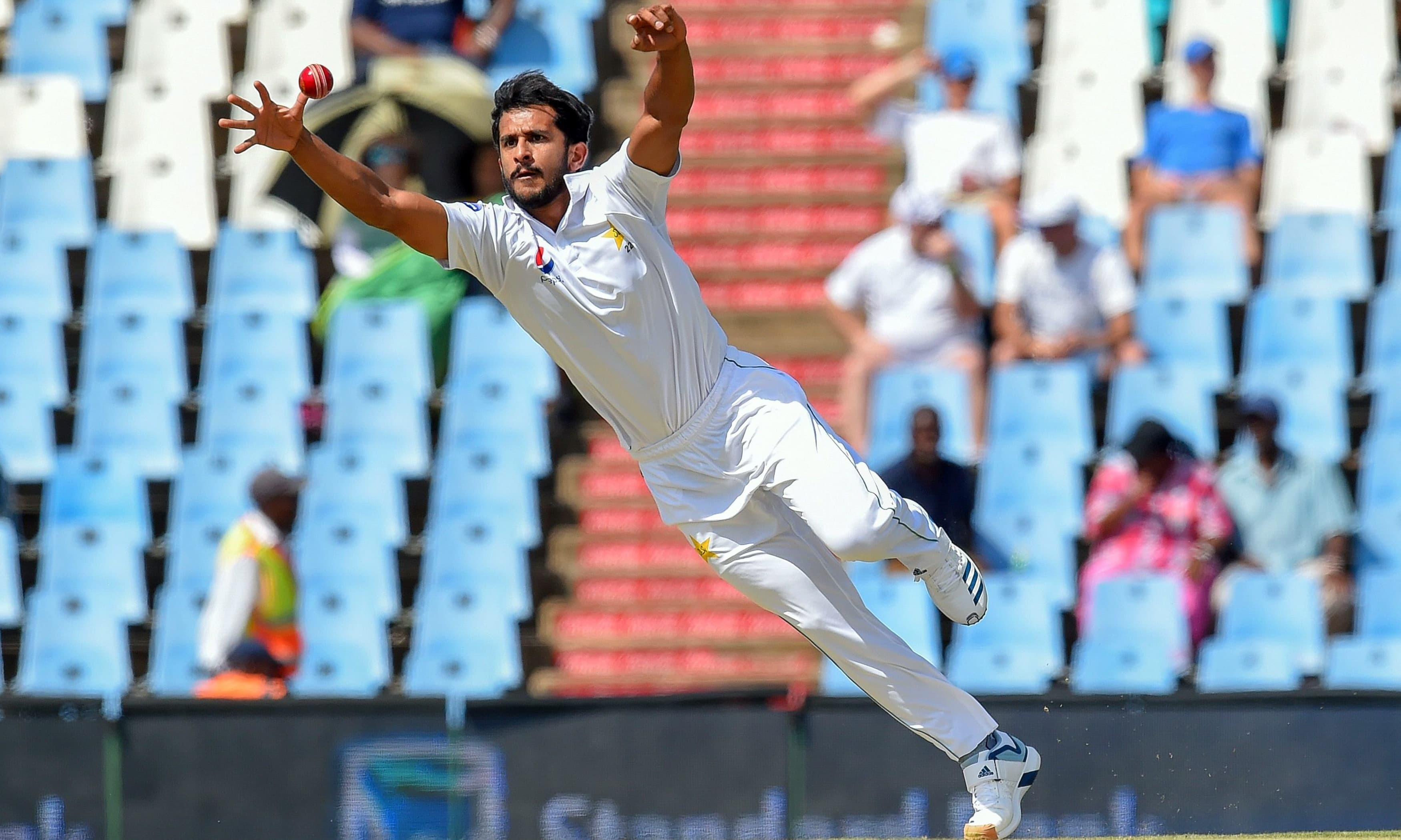 Hasan Ali fields off his own bowling during day one of the 1st Test match between South Africa and Pakistan. — AFP