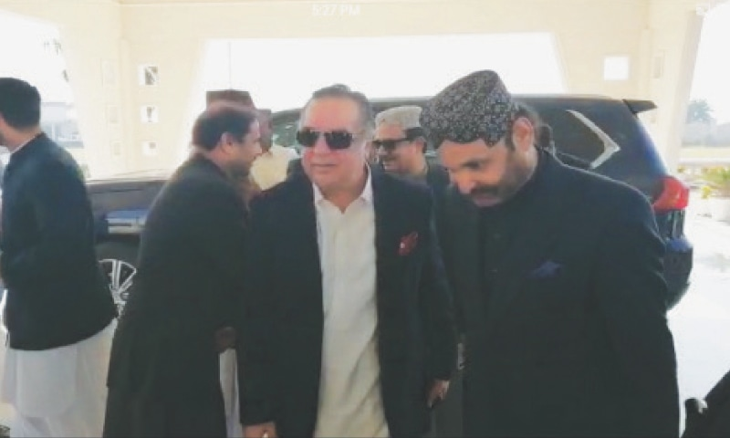 GOVERNOR Imran Ismail being received by Sardar Ali Gohar Mahar in Khangarh on Saturday.—Dawn