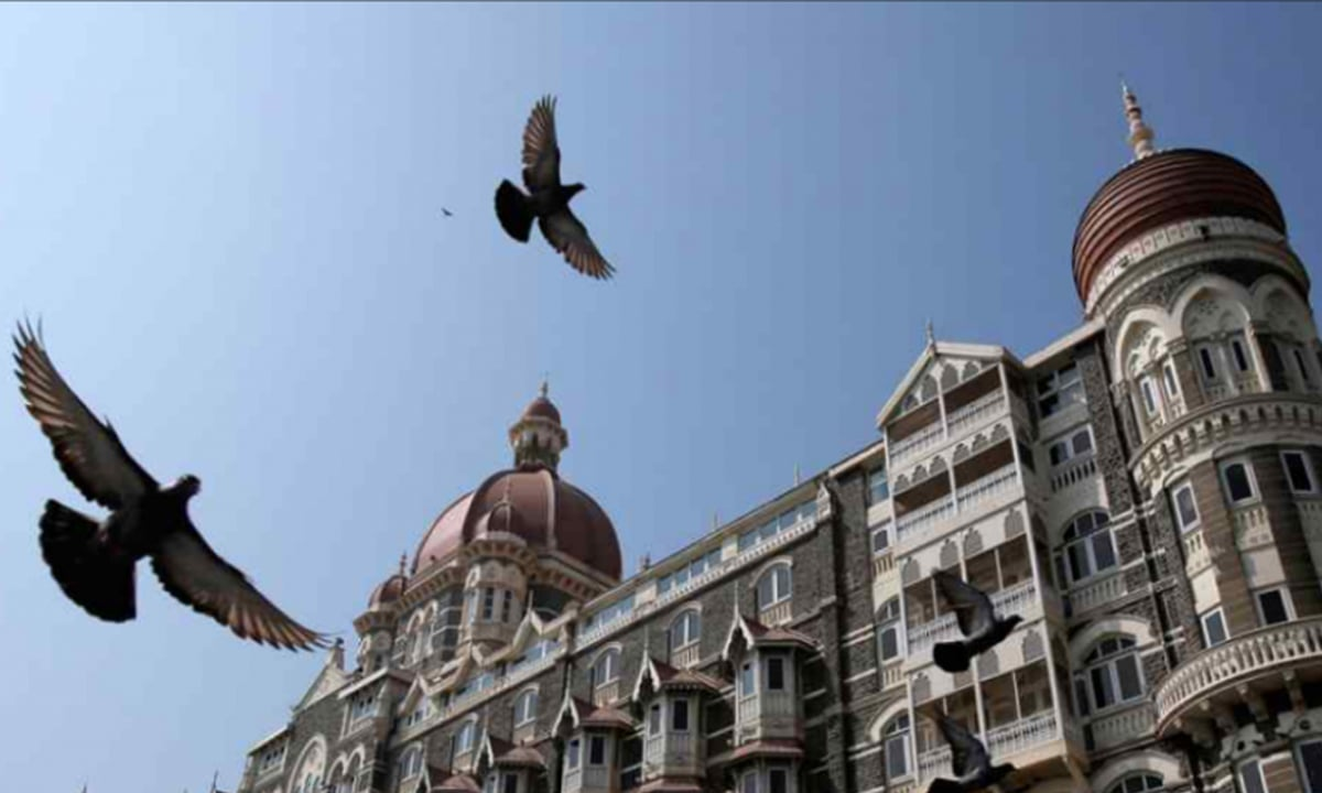 Pigeons fly outside the Taj Mahal Hotel, which was one of the targets of the 26/11 attacks in Mumbai in November 2008 | Reuters