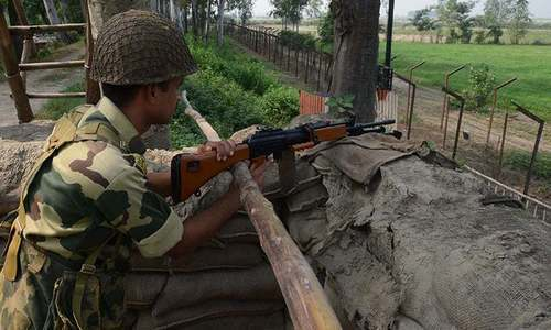 An Indian army soldier takes up position near the Line of Control. — File