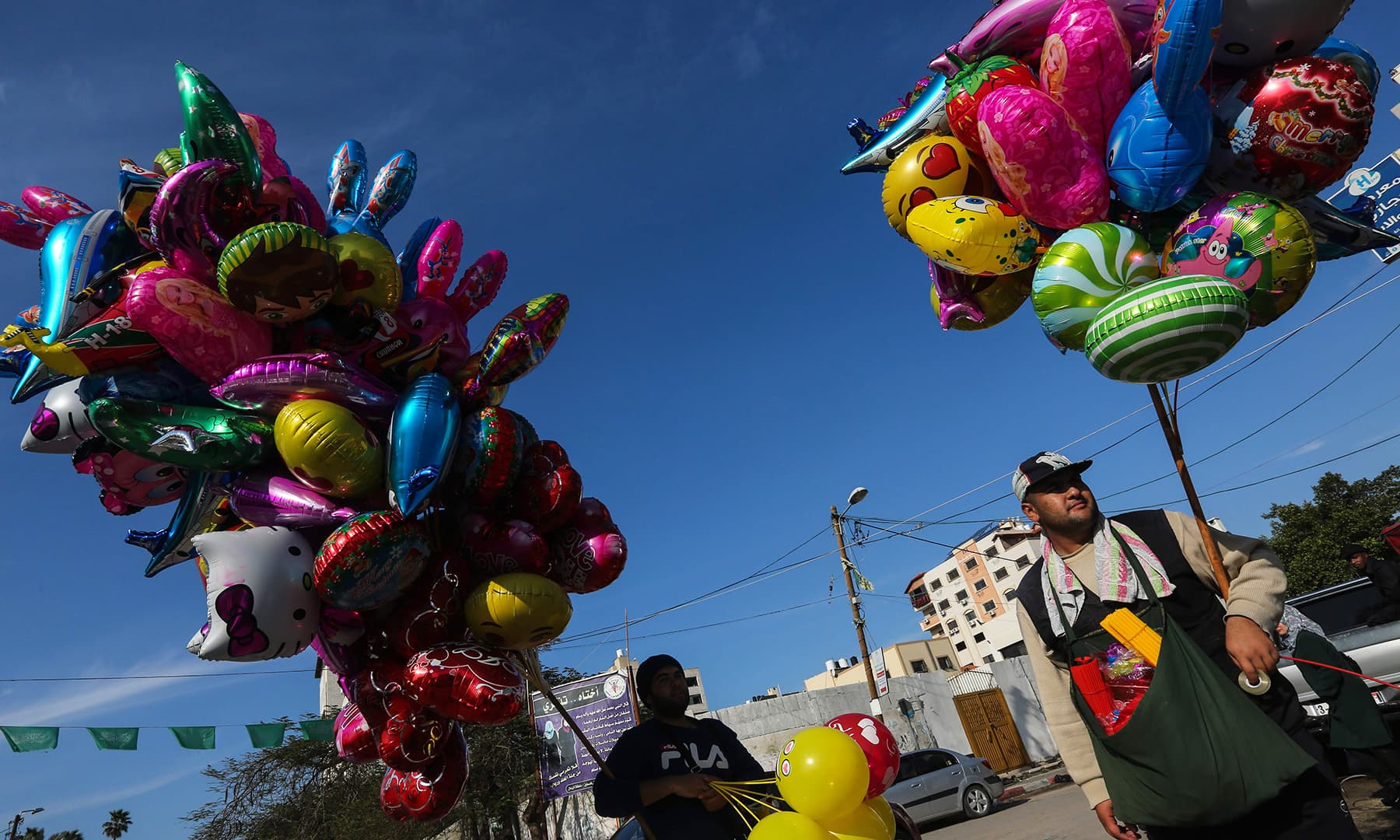 A Palestinian man sells balloons ahead of New Year's celebrations in Gaza City on December 31. — AFP