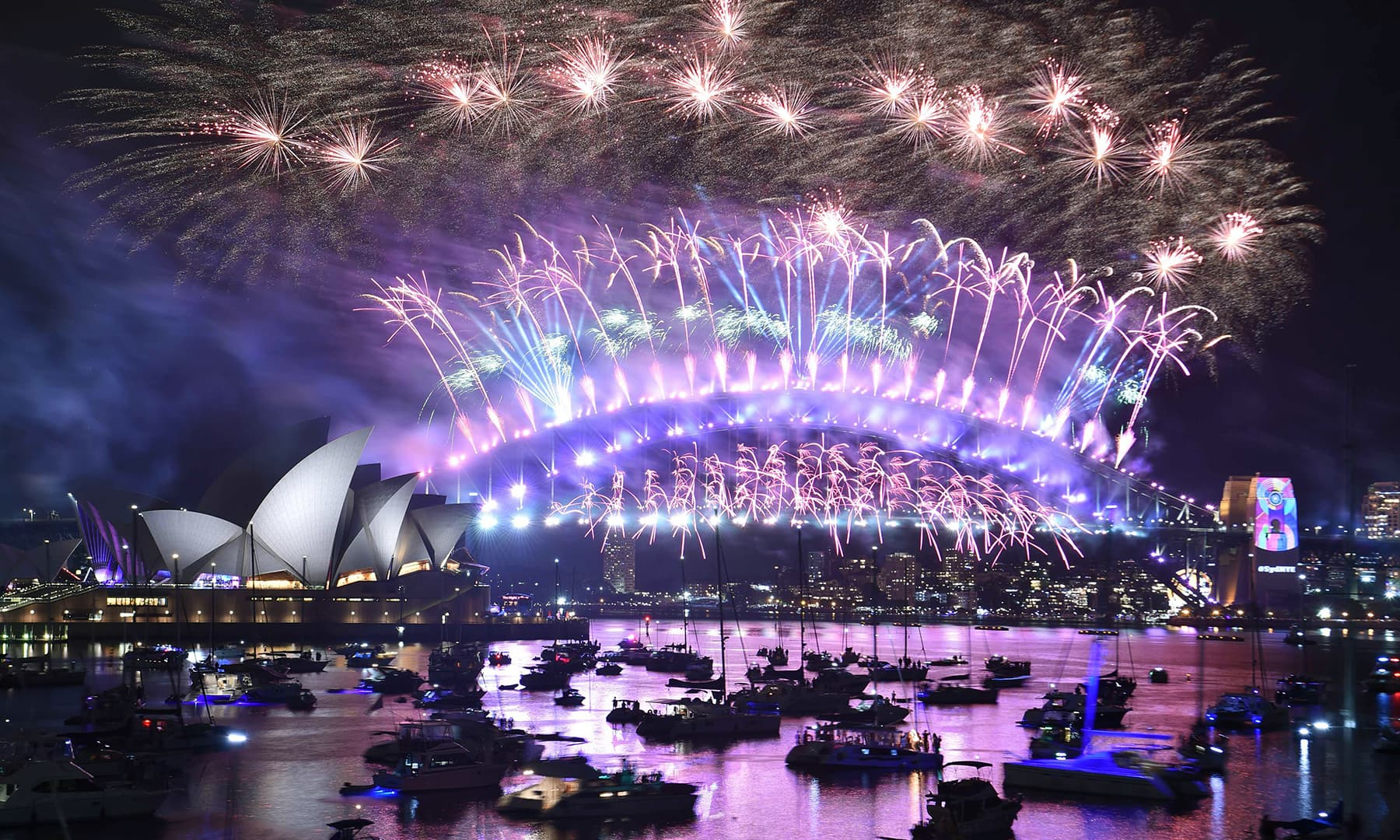 New Year's Eve fireworks erupt over Sydney's iconic Harbour Bridge and Opera House during the fireworks show on January 1. — AFP