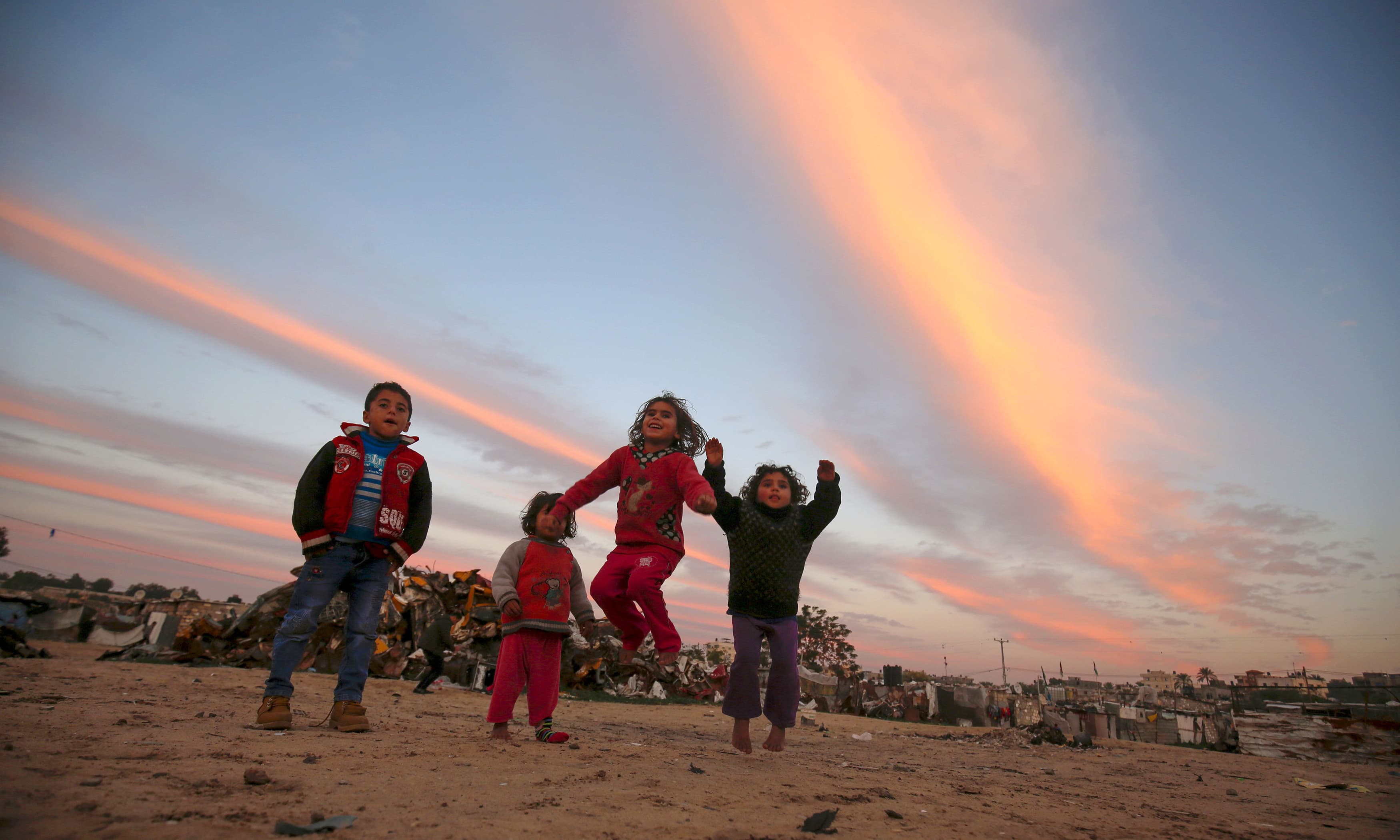 Palestinian children play at a refugee camp in Khan Yunis in the southern Gaza Strip. —AFP