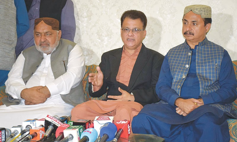 GDA secretary general Ayaz Latif Palijo speaks at the press conference in Qasimabad on Monday.—Dawn