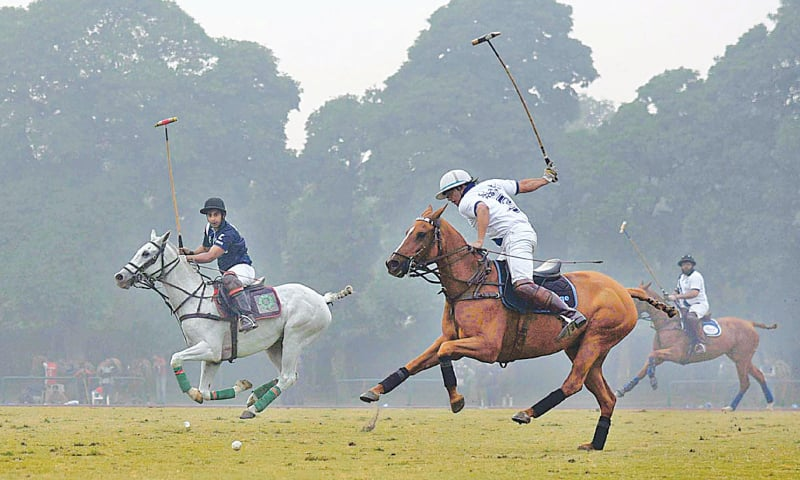LAHORE: Players of Samba Bank and PBG/Remounts teams vie for the ball during their Pakistan Polo Cup match at the Lahore Polo Club on Tuesday.—APP