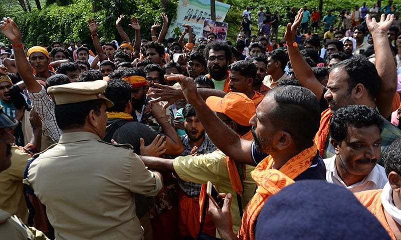 Indian policemen contain Hindu devotees and activist during a protest against the Supreme Court verdict revoking a ban on women's entry to Sabarimala's Ayyappa Hindu temple, in Nilackal in the southern Kerala state on October 17. — File