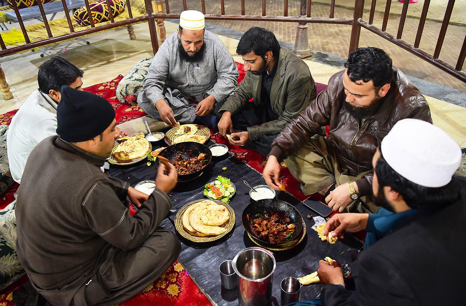 Customers eat grilled meat at the Charsi Tikka restaurant in Namak Mandi in Peshawar. — AFP