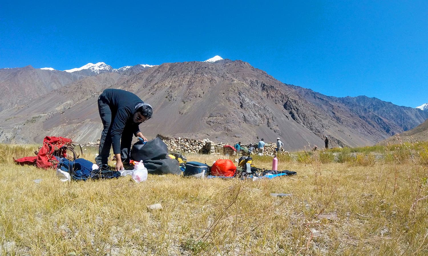 Day 5: Taimoor sifting out the gear we will need for the summit attempt at Dhee base camp.