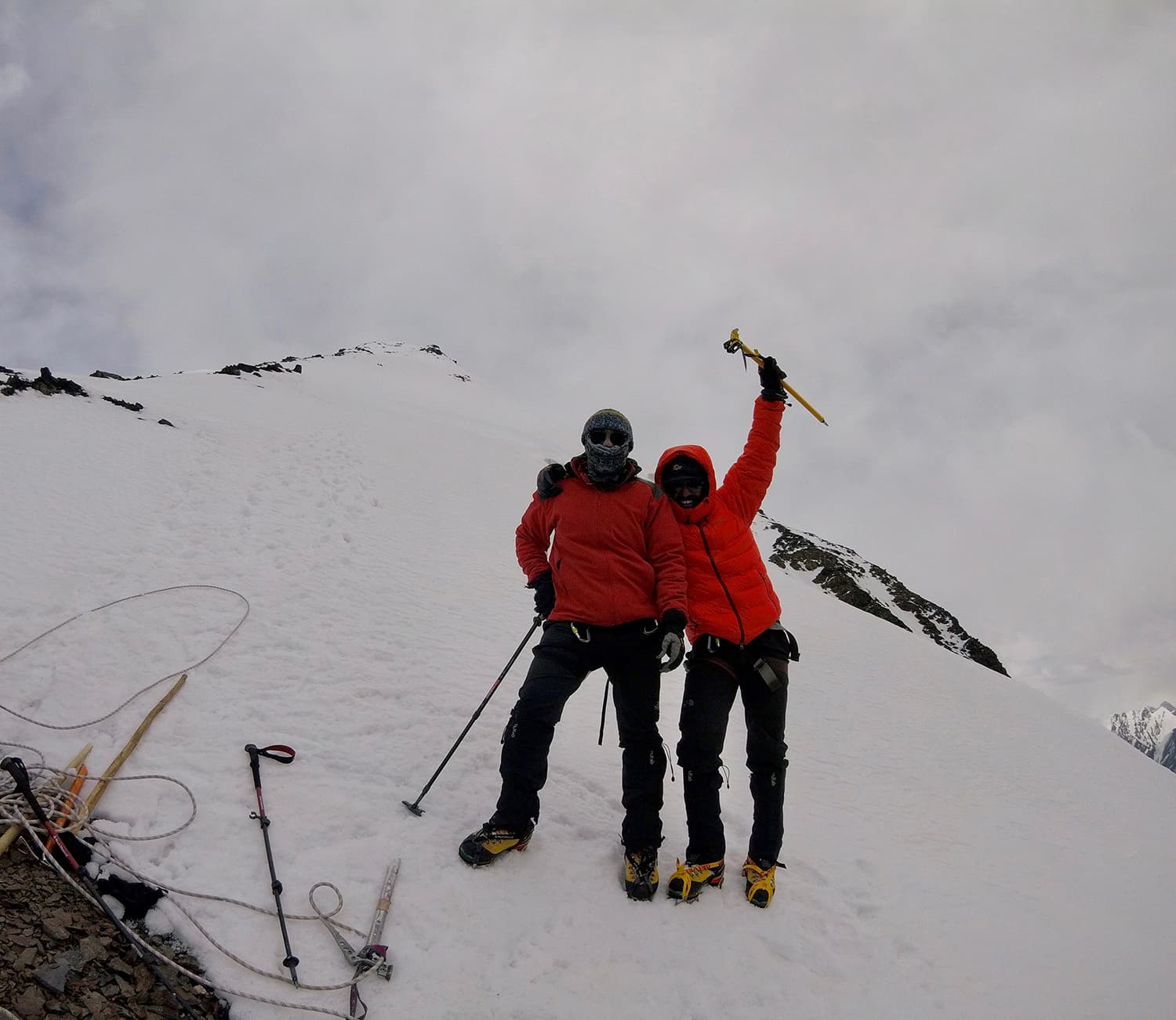 Day 7: A sigh of relief as we descend from the summit to cross the snow line back onto the rocky terrain.