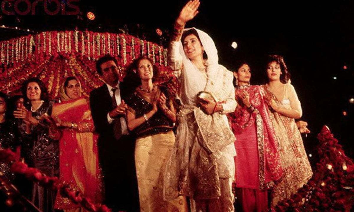 Benazir waves to the crowd at her wedding celebrations held in Karachi's Lyari are in 1987 | dawn.com