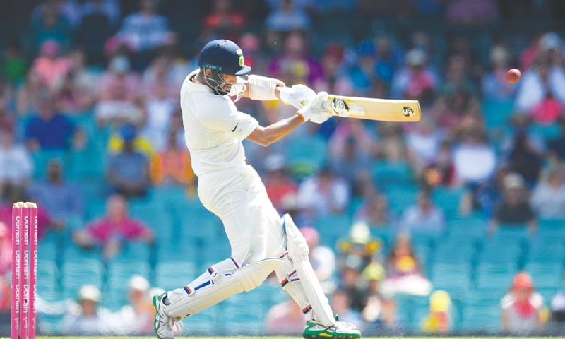 SYDNEY: Indian batsman Cheteshwar Pujara pulls during the fourth Test against Australia at the SCG on Thursday.—AFP