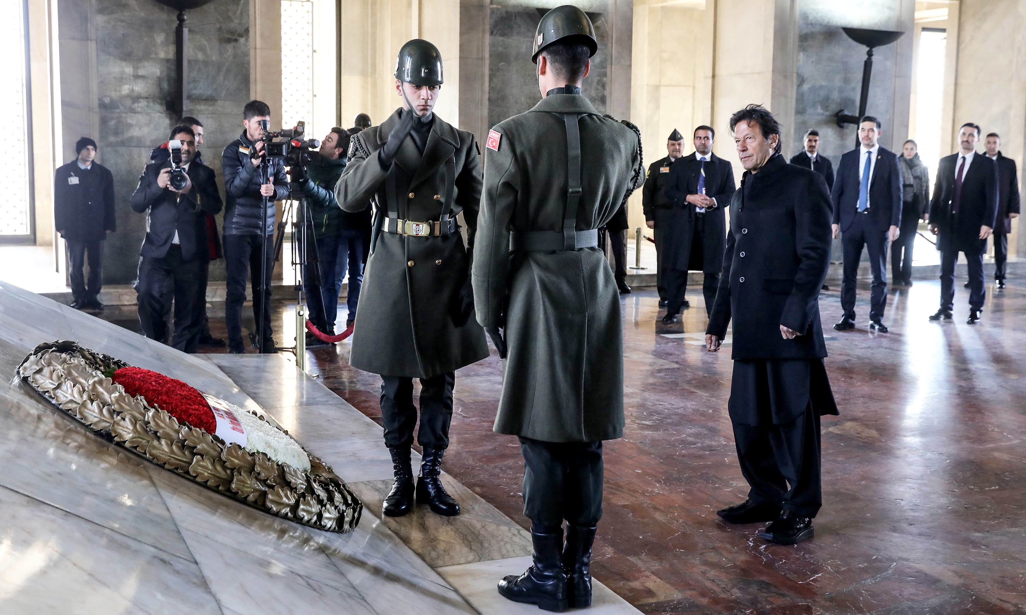 PM Imran Khan attends a wreath-laying ceremony in Anitkabir, the mausoleum of Turkish Republic's founder Mustafa Kemal Ataturk, as part of an official state visit in Ankara. —AFP