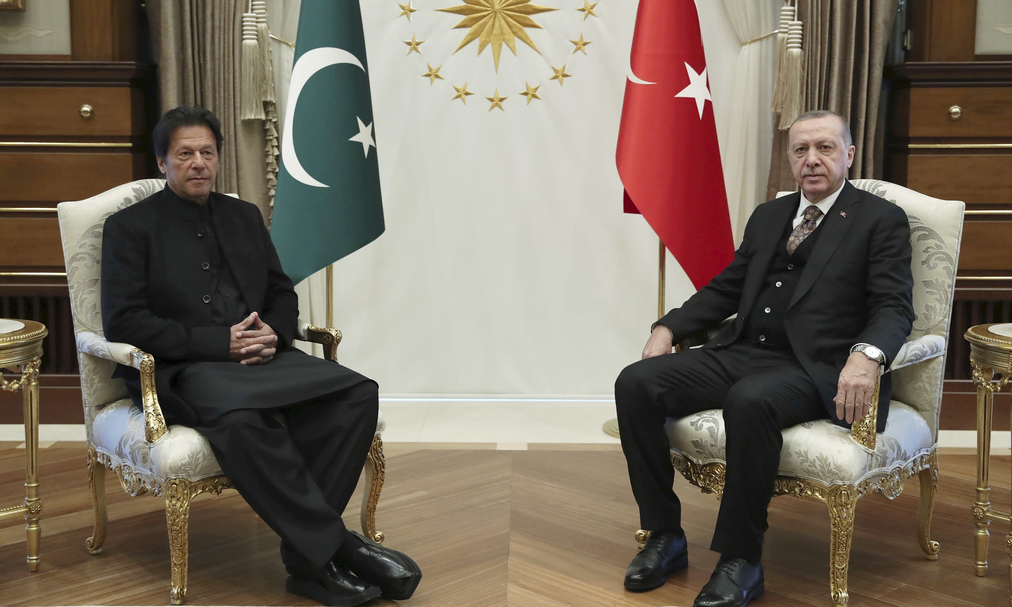 Turkey's President Recep Tayyip Erdogan and PM Imran Khan pose for the media before a meeting in Ankara. —AP