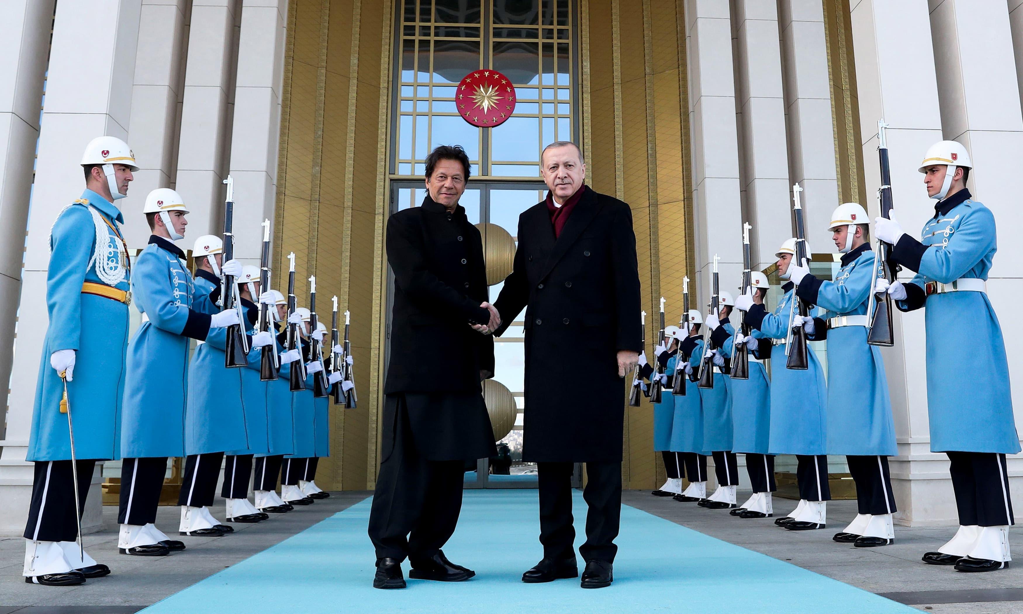 Turkish President Recep Tayyip Erdogan welcomes PM Imran Khan ahead of their meeting at the Presidential Complex in Ankara. —AFP