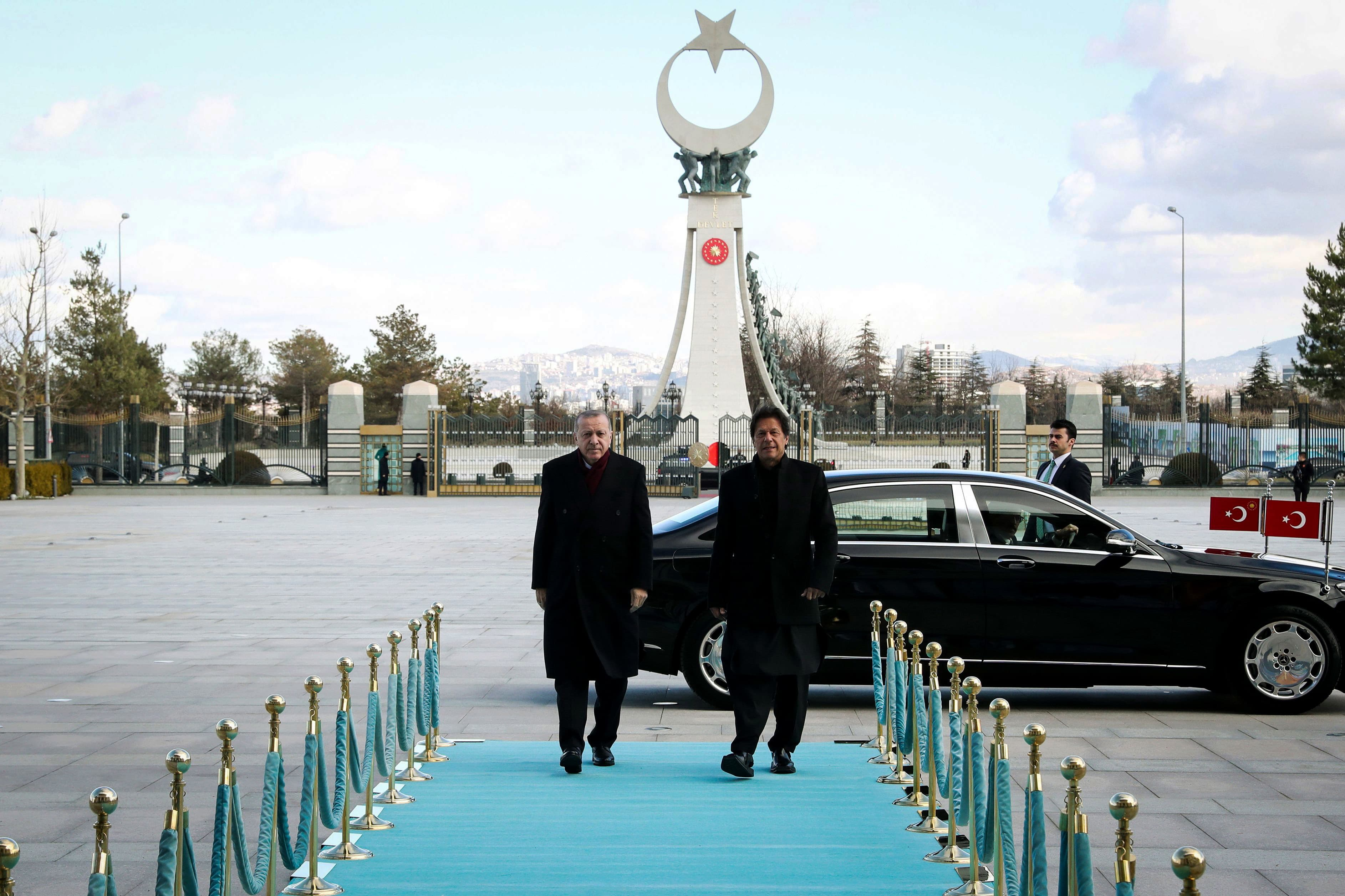 "A handout picture taken and released by the Turkish Presidential Press Office, shows Turkish President Recep Tayyip Erdogan (L) welcoming Pakistan's Prime Minister Imran Khan (R) ahead of their meeting at the Presidential Complex in Ankara, on January 4, 2019. (Photo by KAYHAN OZER / AFP) / RESTRICTED TO EDITORIAL USE - MANDATORY CREDIT ""AFP PHOTO / TURKISH PRESIDENTIAL PRESS OFFICE/ KAYHAN OZER"" - NO MARKETING NO ADVERTISING CAMPAIGNS - DISTRIBUTED AS A SERVICE TO CLIENTS — AFP or licensors"