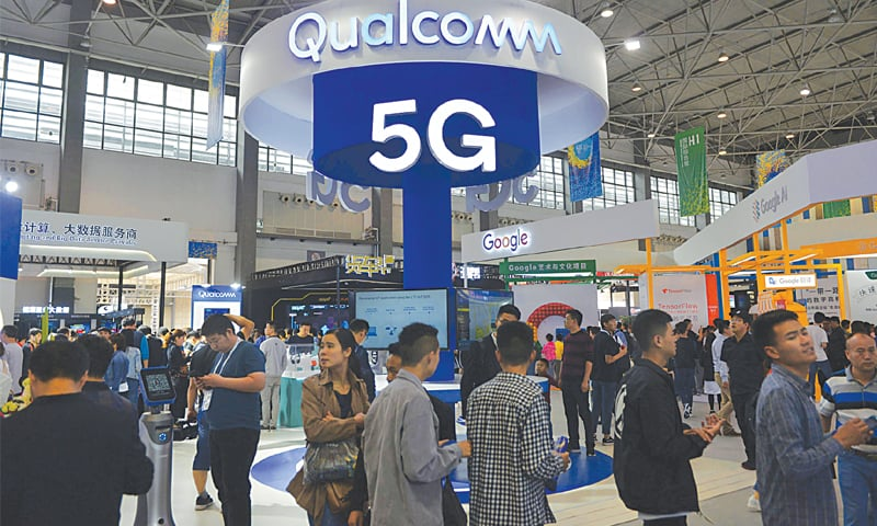 Visitors are seen by a booth of Qualcomm Inc at the China International Big Data Industry Expo in Guiyang, Guizhou province—Reuters file photo