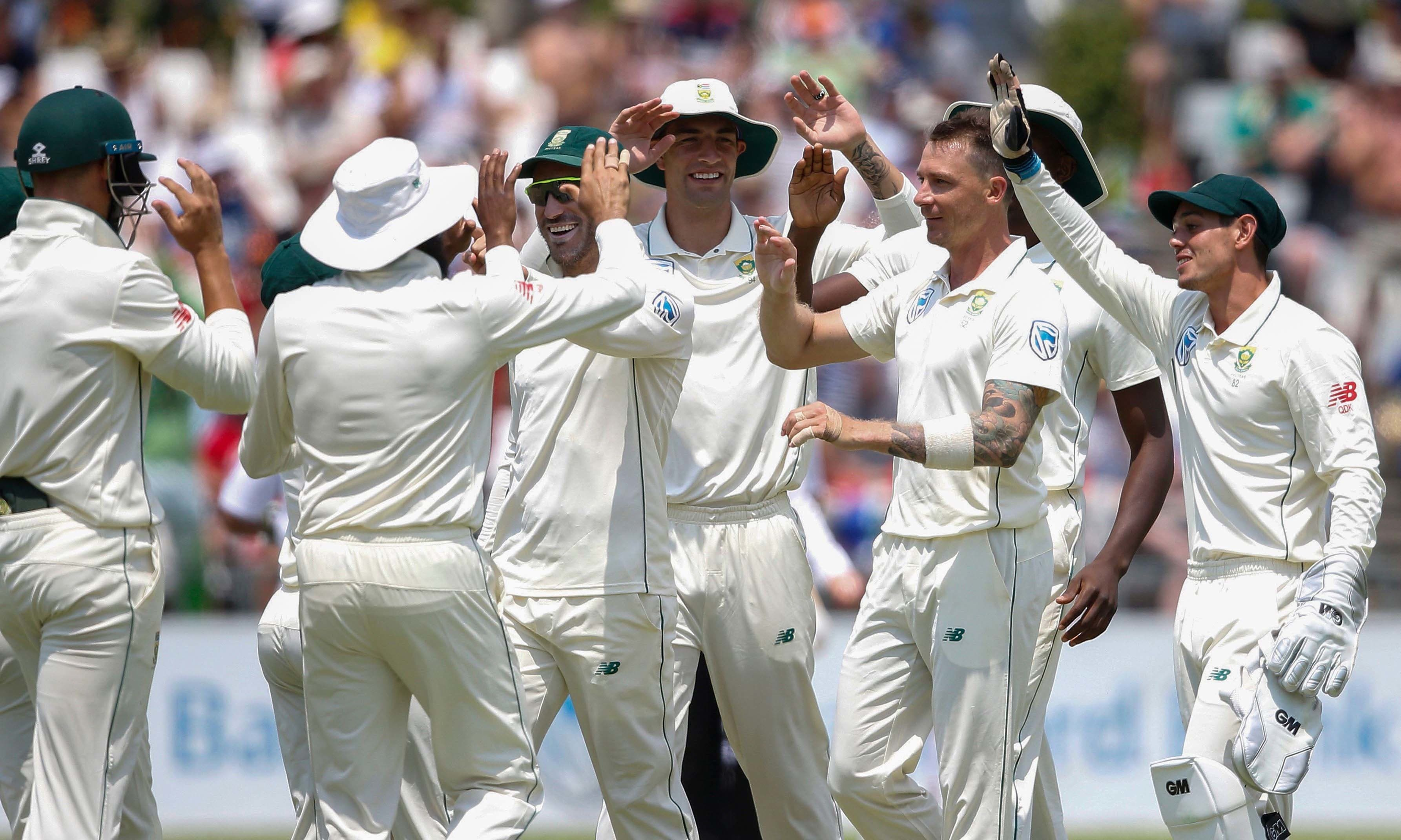 South African bowler Dale Steyn celebrates with teammates after the dismissal of Imam-ul-Haq  — AFP